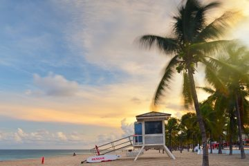 Sunset at Sunrise Beach in Ft. Lauderdale with palm trees and beach entry feature.