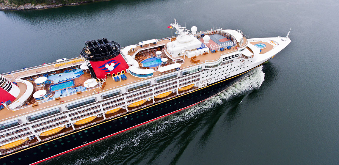 A view of a cruise ship from above with pools clearly visible on the top deck.
