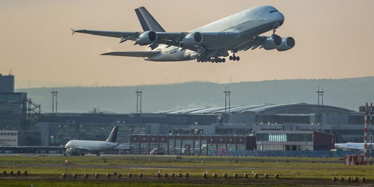 A plane takes off of the runway outside the Frankfurt Airport.