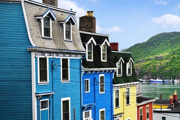 Colorful paneled houses along a street.