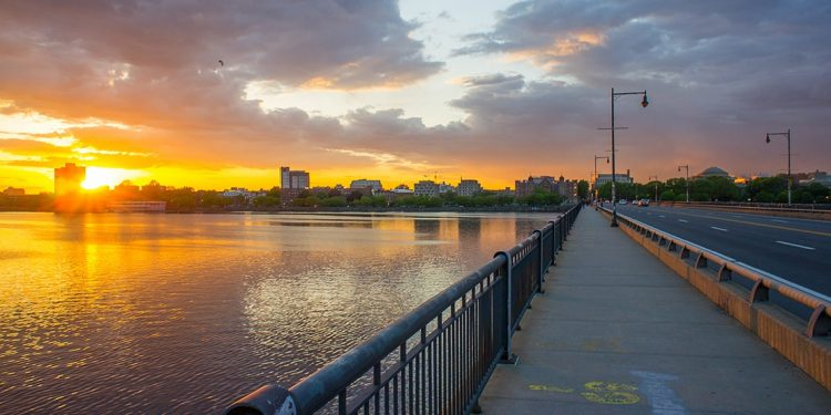 The sun setting over the Charles River, viewed from the Charles River Esplanade