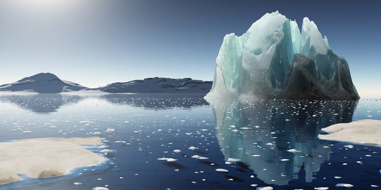 A shiny iceberg jutting out of the ocean with specks of ice floating alongside.