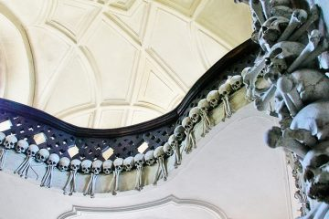 Balcony railing adorned with human skulls and bones