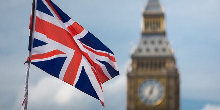 Union jack in front of clock on Big Ben