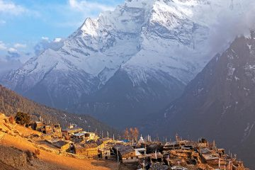 Small village of Nepal with Himalayas in the background