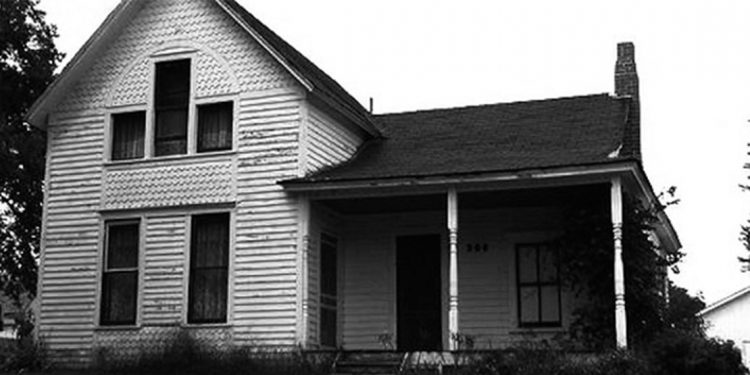 Black and white photo of an old house.