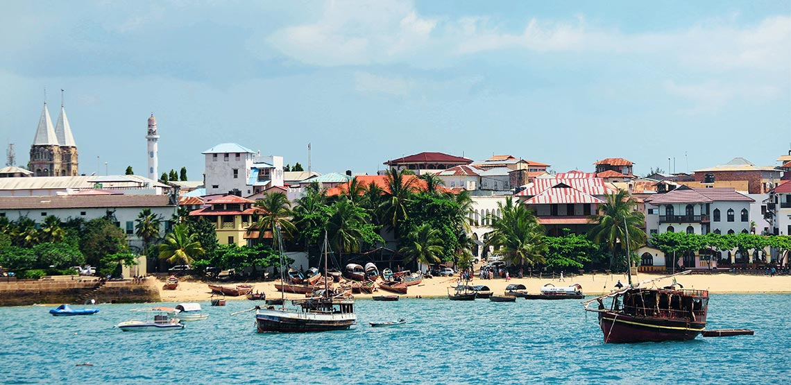 A view of Stone Town in Zanzibar from the ocean.