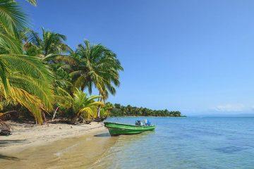 a boat on the beach in Bocas del Toro, Panama