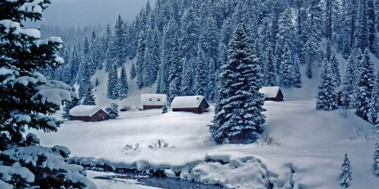 Cabins in a wintery mountain scene