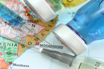 travel vaccination needles on a map