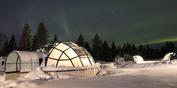 Glass igloo with view of the Northern Lights