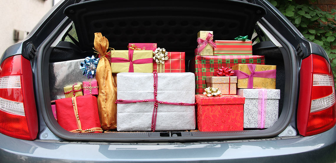 Wrapped presents in trunk of car.