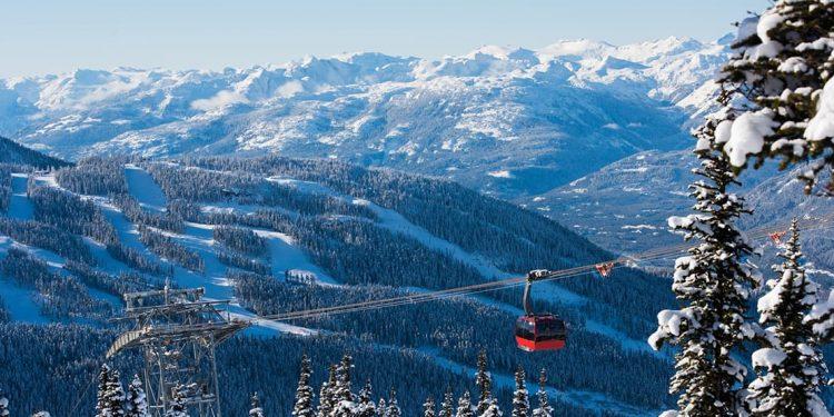Gondola over mountain range.