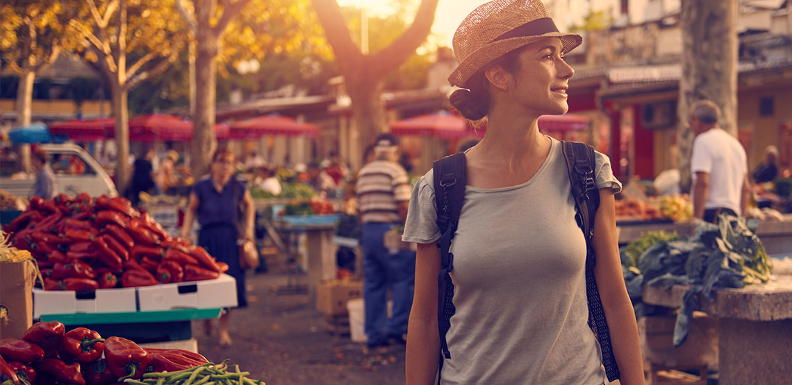 Woman standing in market.
