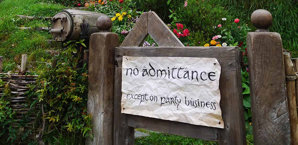 "Sign on gate reading ""no admittance except on party business"""