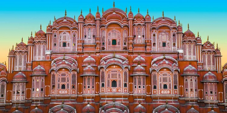A frontal view of the The Palace of the Winds (also known as the Hawa Mahal) and its delicately carved rose-colored windows