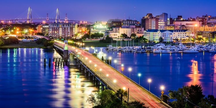 A Charleston, South Carolina skyline over the Ashley River viewed at night