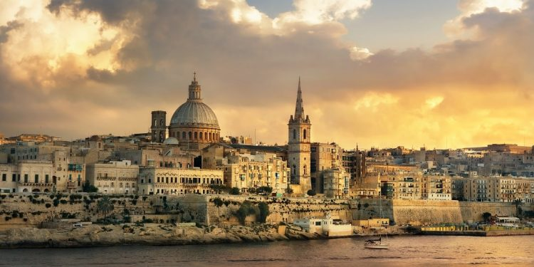 Malta's Valletta skyline waterfront at sunset