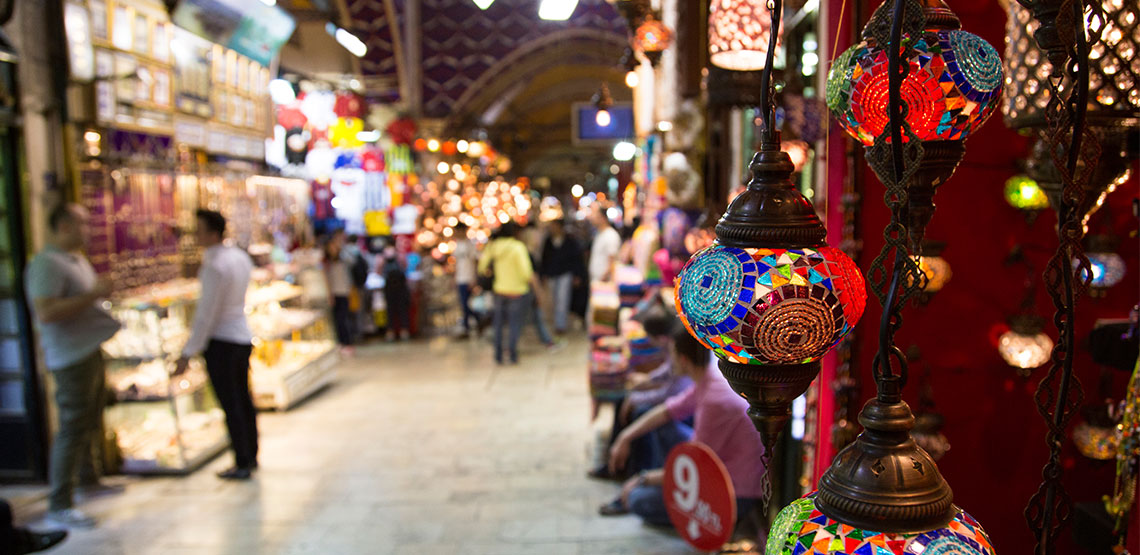 An indoor marketplace with colorful lights