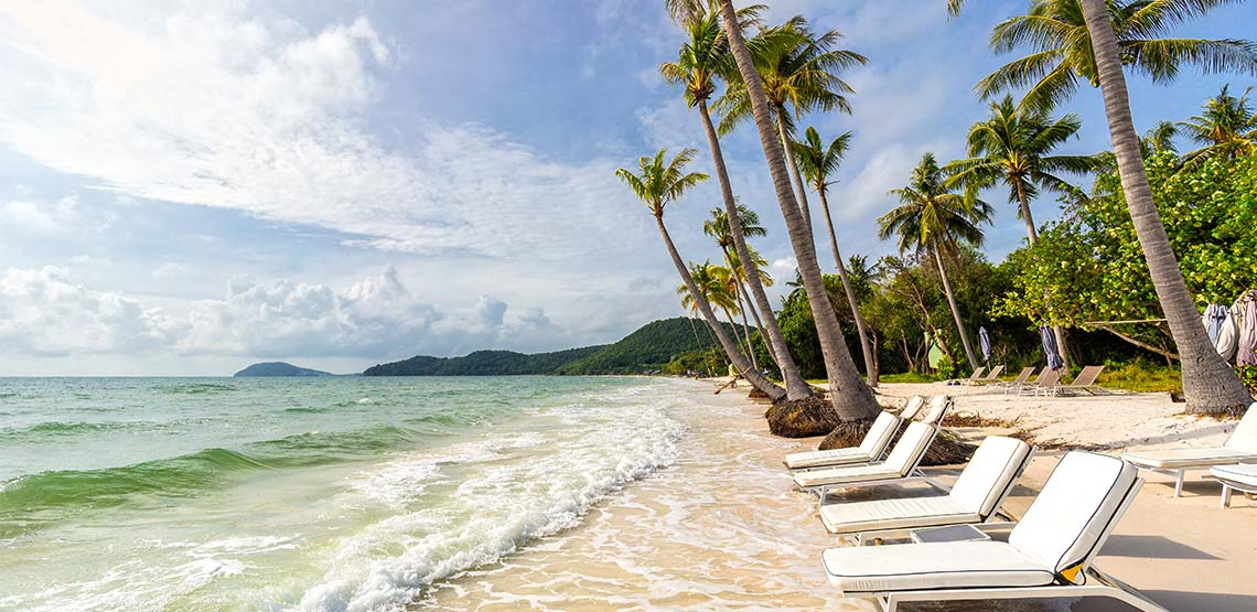 Beach it Vietnam with chairs and palm trees