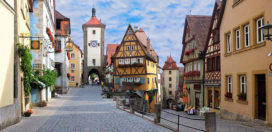 Cobble stone street with charming Bavarian buildings.