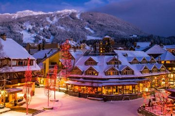 Scenic Whistler village with snowy Blackcomb mountain in background