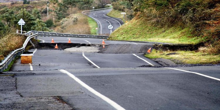 A broken road as a result of a hurricane.