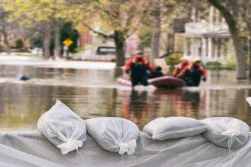 sandbags hold back a flood on a street during a hurricane