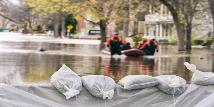 sandbags hold back a flood on a street during a hurricane