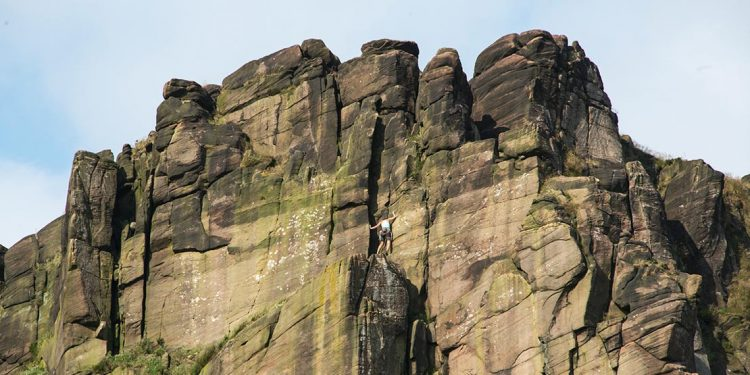 Someone rock climbing at The Roaches