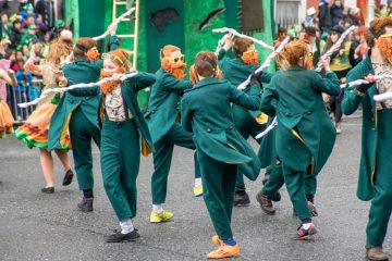 People dressed in green and with beards dancing in streets of Dublin.