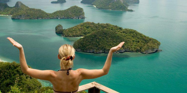 A woman meditates on koh Samui Thailand