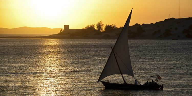 dhow sailboat at sunset off the coast of Lamu, Kenya