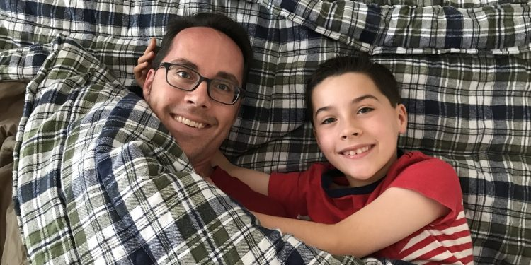 Father and son in two-person sleeping bag