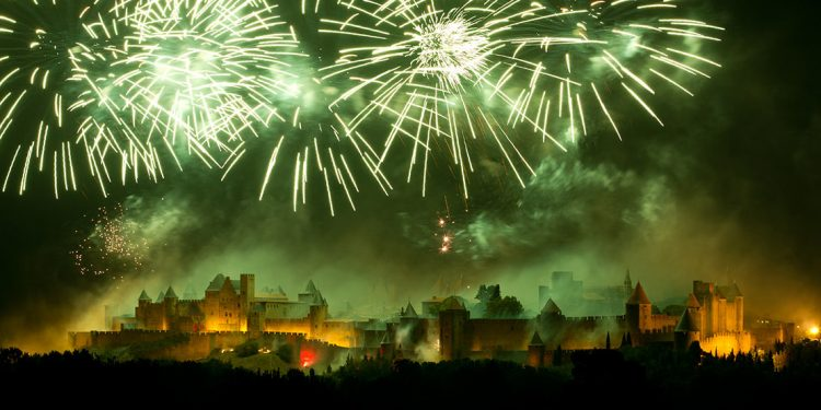 Green fireworks over medieval walls in Carcassonne