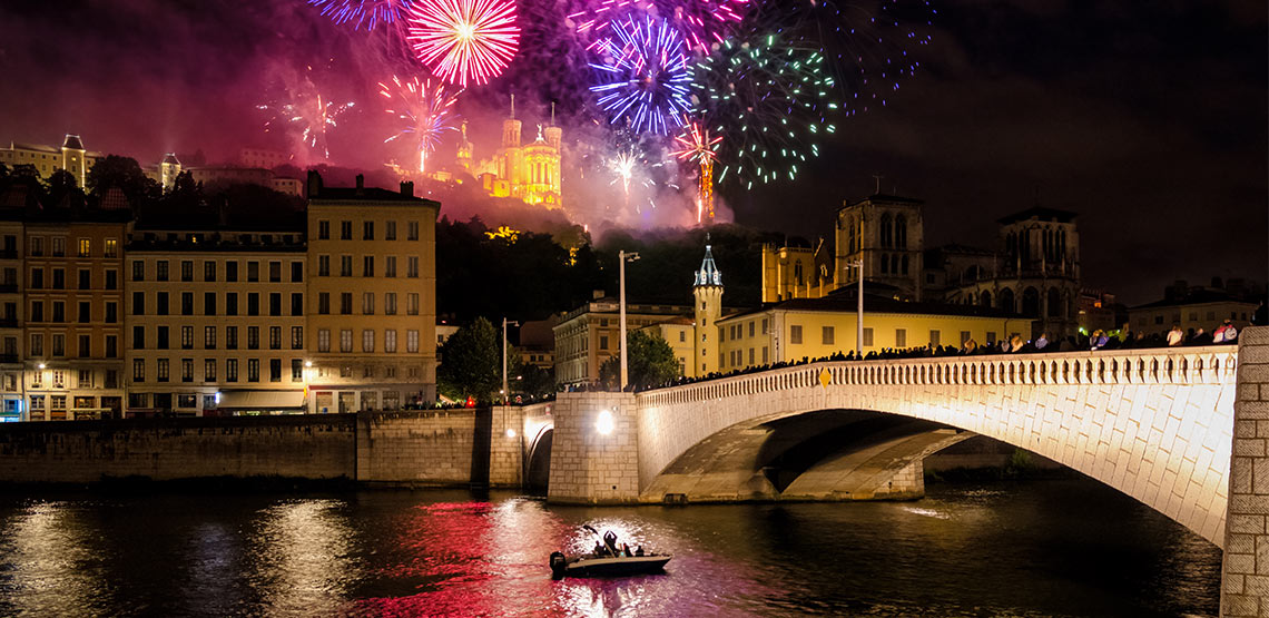Fireworks over river and bridge