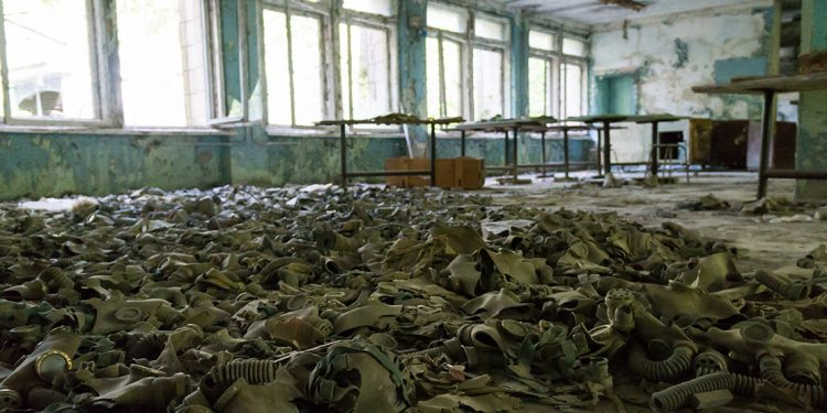 Discarded gas masks on the floor of a room in Chernobyl
