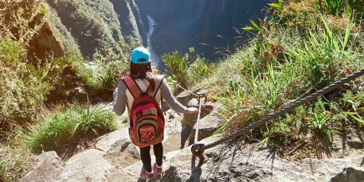 Woman hikes Inca Trail in Peru