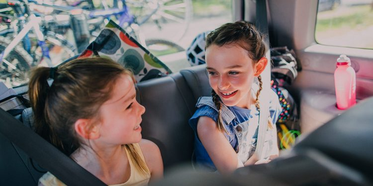 Two girls in the backseat