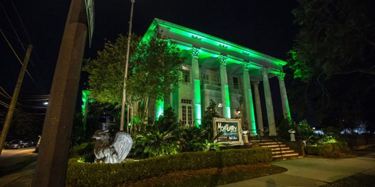 Exterior of The Mortuary, lit up green