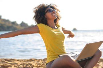 Woman wth laptop on the beach