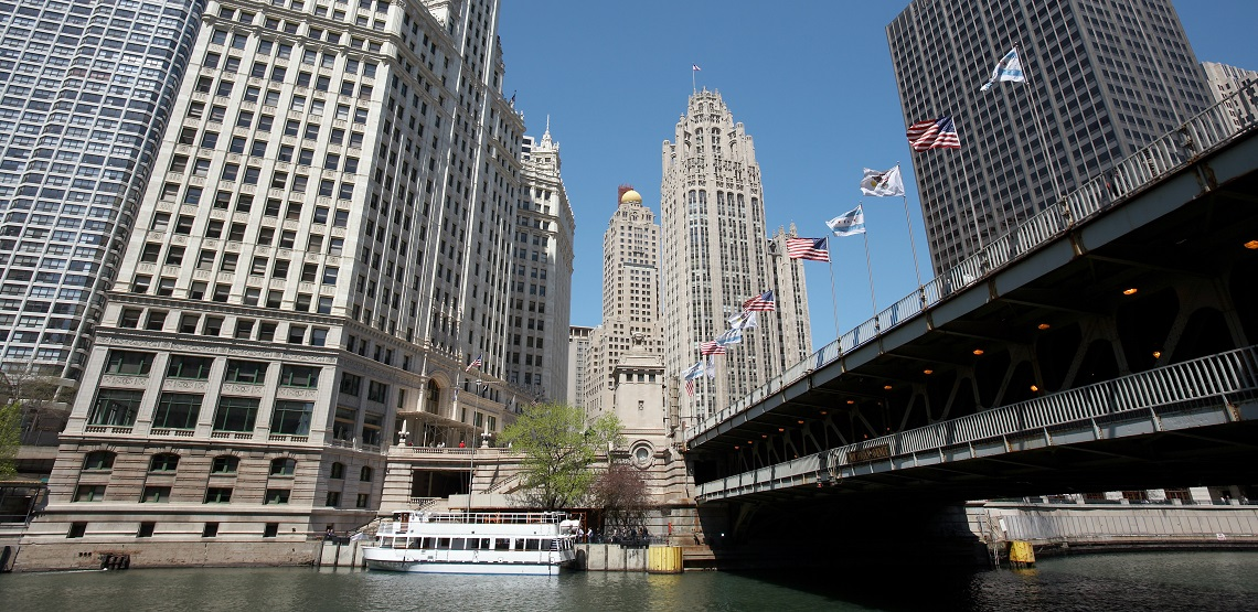 Views of Chicago's Wrigley building and tribune towers from a Michigan Avenue river walk.