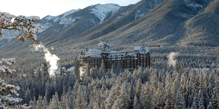 Banff Springs Hotel among snow covered trees in the wintertime