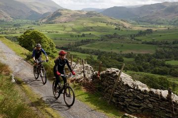 Two people cycling through Peaks District