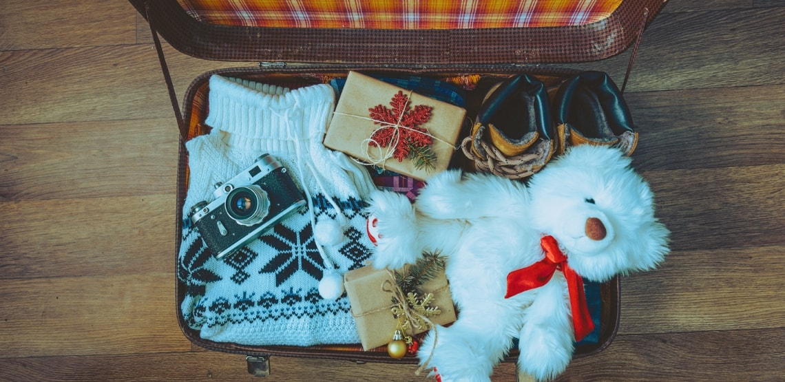 Open Suitcase with Christmas gifts