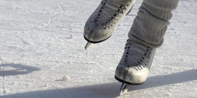 Ice skates on outdoor rink