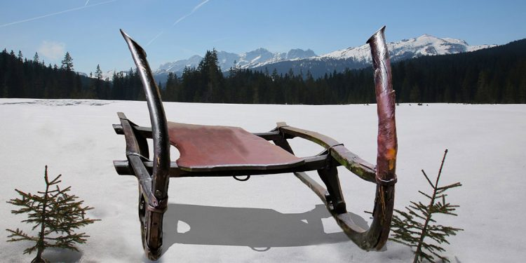 Sled with mountains in background
