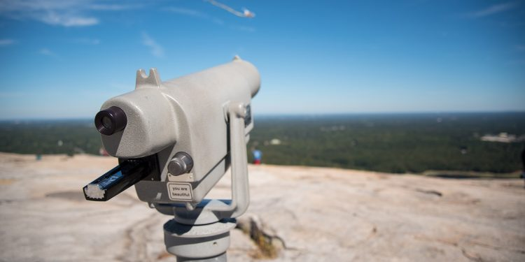 A view from the top of Stone Mountain, Georgia, with a telescope in the foreground