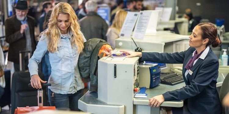 Woman at desk at airport