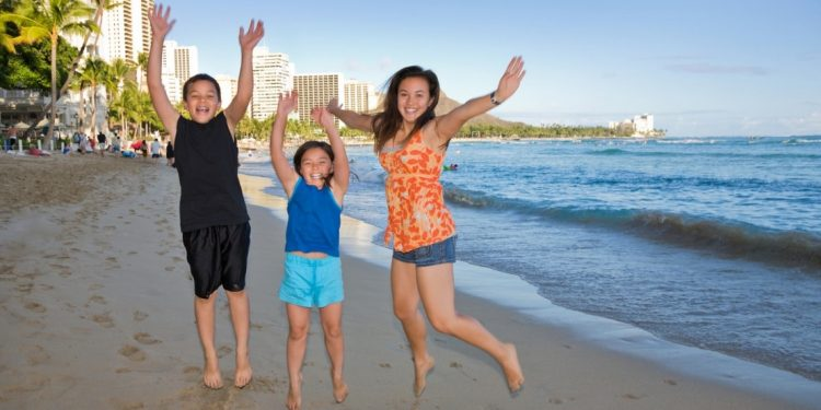 Family on the beach in Honolulu